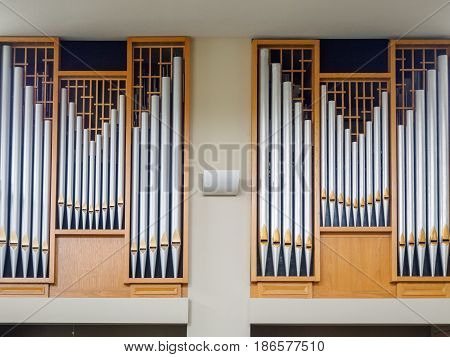Organ pipes of silver anfd brass in the church