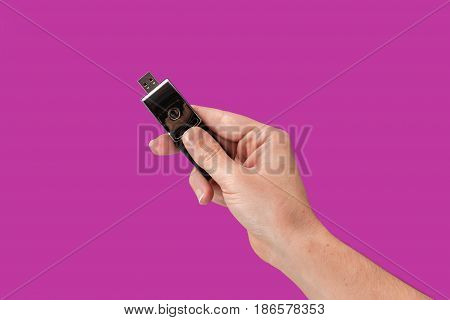 Metal Flash Drive On Hand With Isolated Purple Background