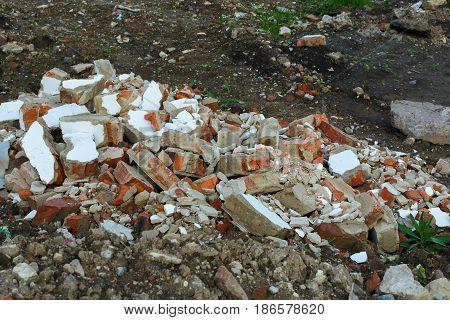Construction garbage. Broken wall Bricks. Pollution by building materials.