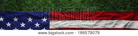 Red, white, and blue American flag on grass for Memorial Day or Veteran's day background