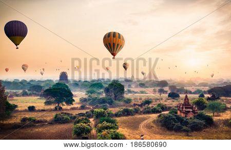 Hot air balloon over plain of Bagan in misty morning, Myanmar. (Burma)