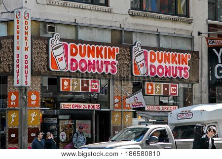 New York May 08 2017: Exterior signs on one of Dunkin Donuts locations in Manhattan.