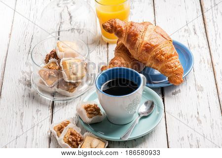 breakfast with coffee orange juice brioche and cookie