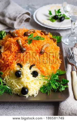 colorful salad is decorated in the form of a hedgehog. idea for children's menu. Selective focus