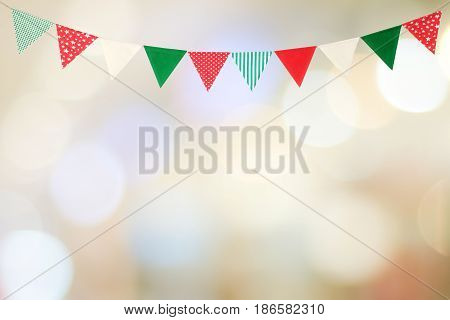 Bunting party flag on blur abstract bokeh light background with copy space for text holiday concept background