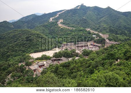 People visits Great Wall of China not far from Beijing, top view