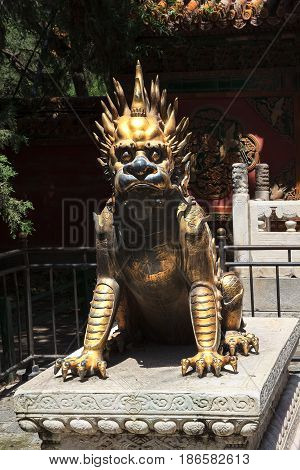 Bronze statue of mythical chinese dragon in Forbidden city, Beijing, China