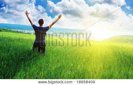 Man in meadow green meadow. Emotional scene.