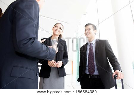 Business people discussing in office building hallway