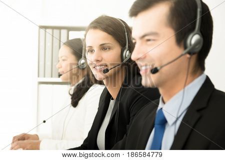 Business people working in call center as the operators or telemarketers