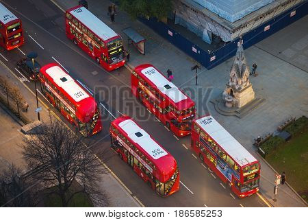 London, UK - December 19, 2016: London red busses at the City of London road. View down from the office block