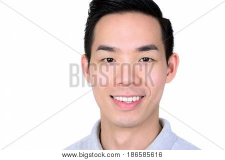 Portrait of smiling young Asian man isolated on white background