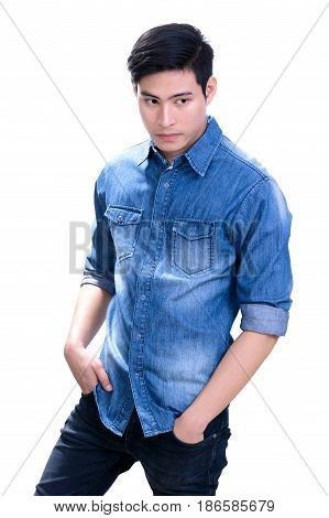 Portrait of handsome young Asian man in blue jean shirt - on white background