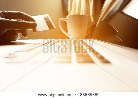 Man Hand Holding Credit Card With Online Shopping Or Internet Banking Concept.