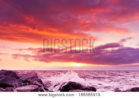 Sunset over Waves Fiery Backdrop