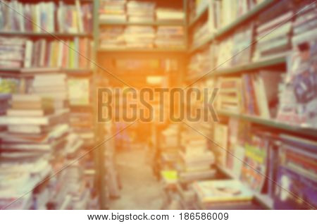 Vintage style color tone. Blur image of a old bookstore .