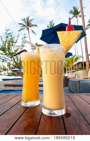 Pineapple smoothies refreshing tropical non-alcoholic drink on the table