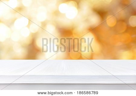 White wood table top on gold bokeh abstract background - can be used for display or montage your products