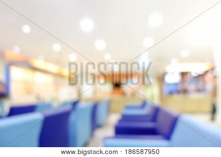 Blur hospital lobby with blue couches can be used as background