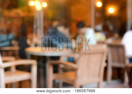 Blurred image of cafe (coffee shop) interior for background