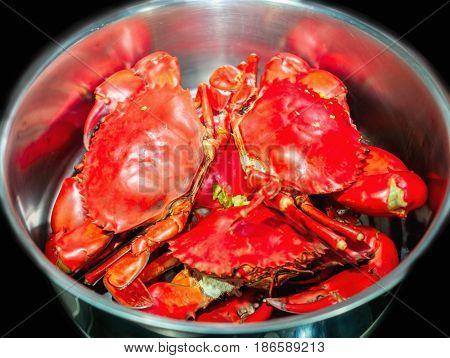 Steamed mud crab in a big pot.