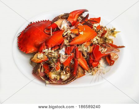Steamed mud crab hard shell after eating in a white plate isolated on white background.