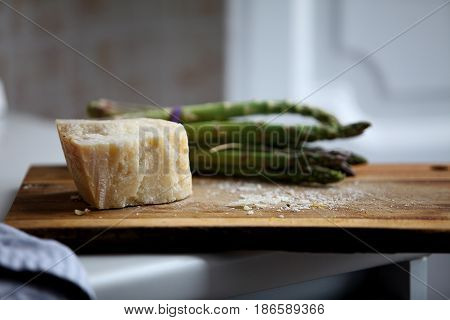 Still life with delicious asparagus and cheese
