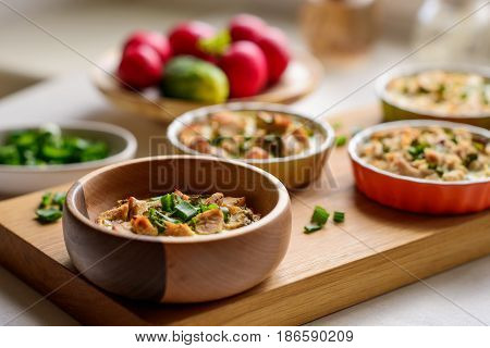 chicken homemade tarts served with vegetables on a wooden board