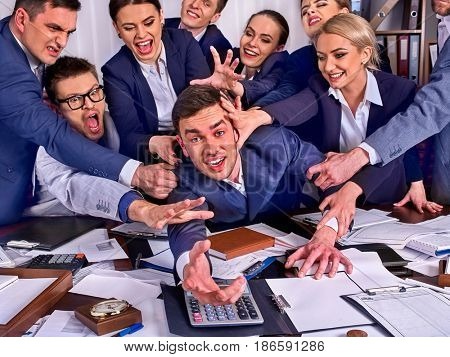 Business people office. Team people are unhappy with their leader. Intern man manager does not cope with his duties. Crowd in stress throw up their chief's papers
