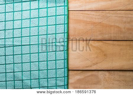 green tablecloth on wood backgroundtop viewempty wooden table for product display
