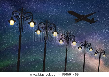 Flying aircraft and vintage lampposts at night. Vector illustration with silhouette of passenger airplane under starry sky