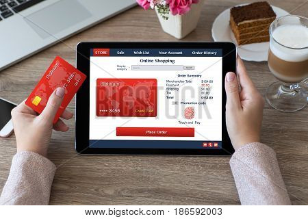 woman hands holding credit card and tablet shoping fingerprint and credit card in online store