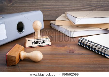 Policies. Rubber Stamp on desk in the Office.
