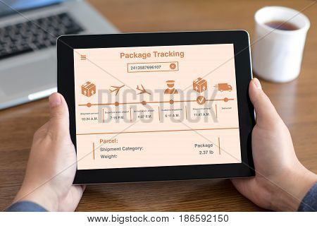 men hands holding tablet with app package tracking on screen