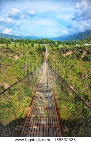 Long Suspension Bridge Over A Deep Gorge