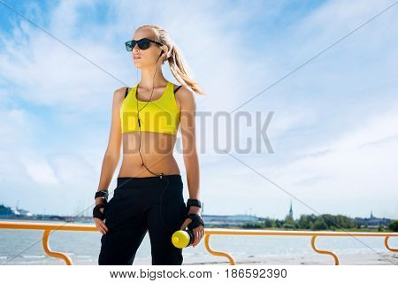Fit, sporty and athletic young woman. Beautiful girl in a sportswear.