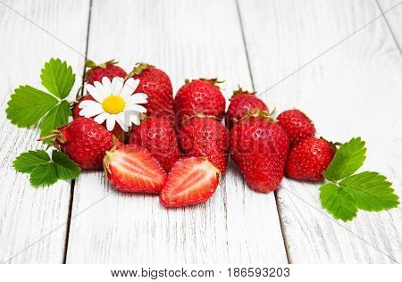 Ripe Strawberries On Wooden Table