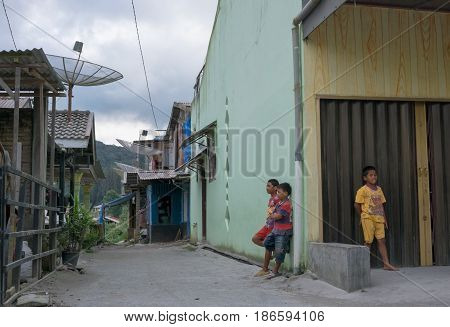 BERASTAGI INDONESIA 15 MAY 2017 : Three indonesian children on the street at countryside area of Berastagi city Northern Sumatra.
