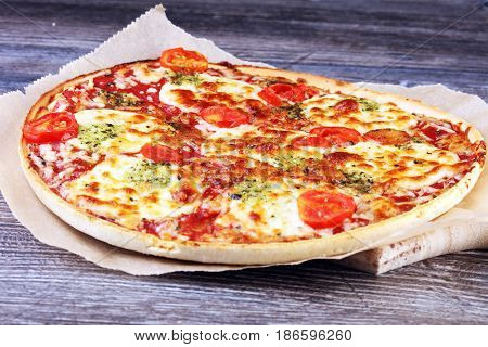 Hot True Italian Pizza With Basil And Cheese. Top View Tasty Traditional Pepperoni Pizza On Board On