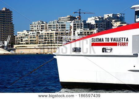 VALLETTA, MALTA - MARCH 30, 2017 - Bow of the Sliema to Valletta ferry with waterfront buildings to the rear Valletta Malta Europe, March 30, 2017.