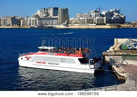 VALLETTA, MALTA - MARCH 30, 2017 - Passengers boarding a ferry heading for Sliema Valletta Malta Europe, March 30, 2017.
