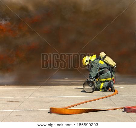 firemen in operation surround with smoke .