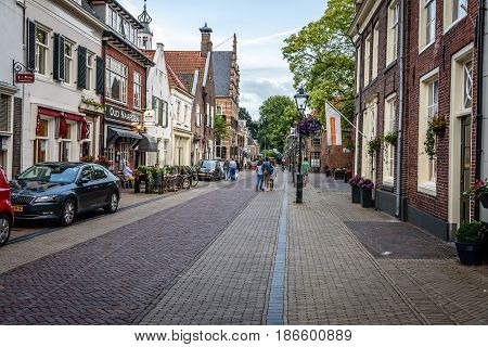 Naarden Netherlands - August 5 2016: Picturesque street in Naarden city centre. Naarden was developed into a fortified garrison town with a textile industry. It is an example of a star fort complete with fortified walls and a moat.