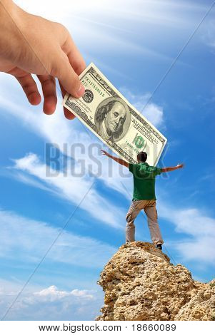 Man on peak of mountain and hand with money. Money conception design.