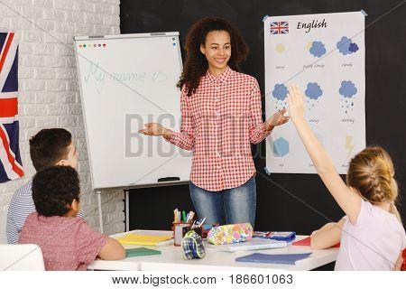 Young Woman Teaching Kids