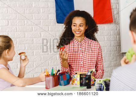 Woman Teaching Kids In Primary School