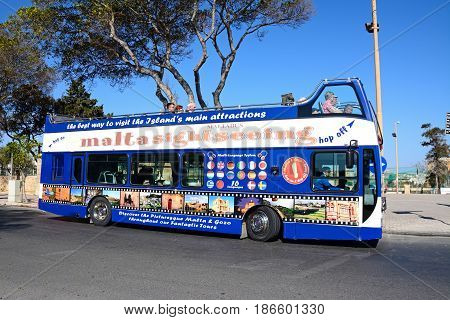 FLORIANA, MALTA - MARCH 30, 2017 - Passengers aboard a bus open topped tour bus Floriana Malta Europe, March 30, 2017.