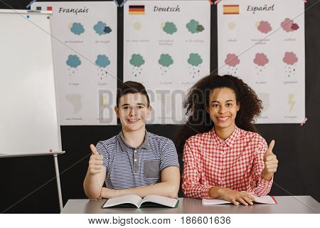 Smiling Boy And Girl With Thumbs Up