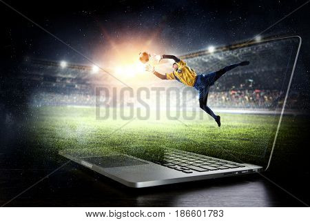 Soccer goalkeeper in action. Mixed media