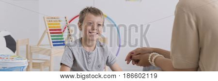 Smiling Boy Looking At Psychotherapist